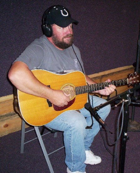 Picture of Ted recording with guitar